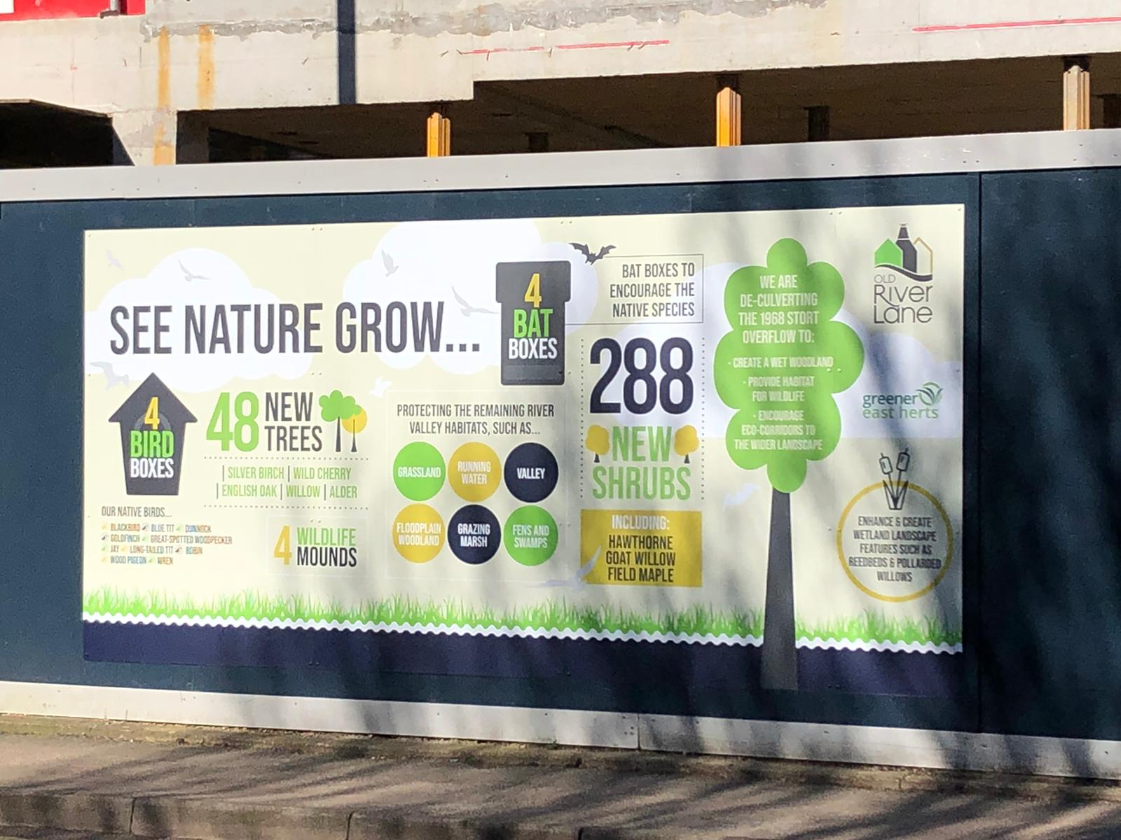 """Northgate End hoarding reads """"see nature grow"""" with image of tree"""