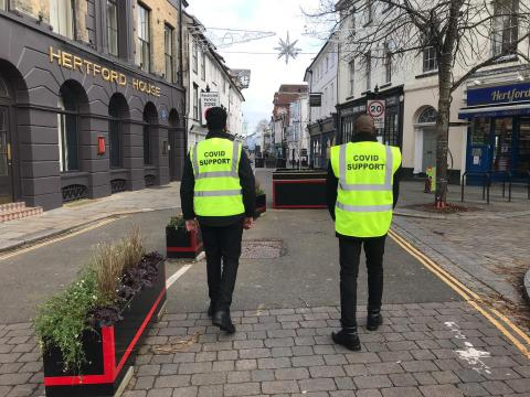 Two Covid marshals patrolling the streets of Hertford