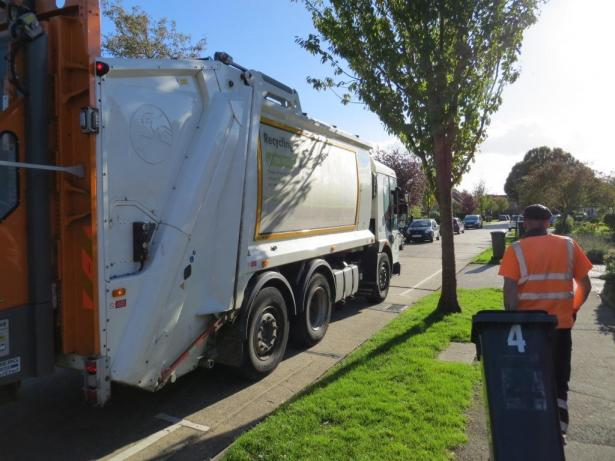 Refuse vehicle and staff collecting waste