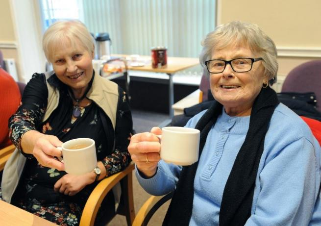 Two ladies enjoying a cup of tea at a Buntingford chatter table