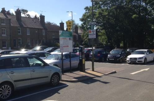 cars parked and pay and display machine at Crown Terrace car park Bishop's Stortford