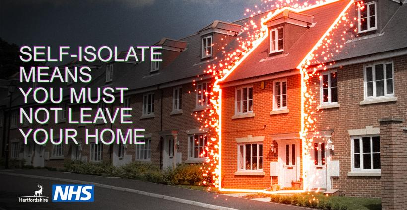 House illuminated with self-isolate means you must not leave your home written in white writing