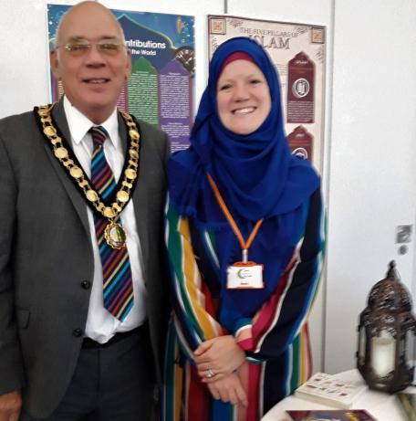 Chairman pictured with lady wearing a head scarf