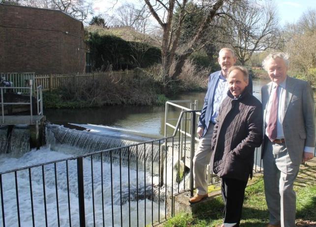 Hydro sluice - 3 men standing next to the river