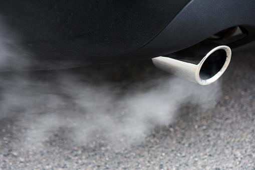 car exhaust pipe blowing fumes