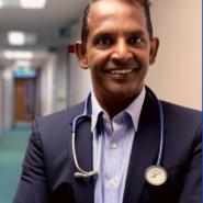 head and shoulders of Dr Prag Moodley, lead GP for East and North Hertfordshire CCG.